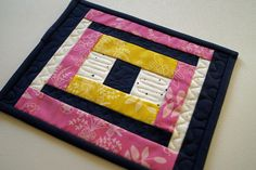 Spring Mini Quilt in Pink, Blue and Yellow, Modern Indigo Patchwork Mug Rug by MyBitOfWonder on Etsy https://www.etsy.com/listing/255082799/spring-mini-quilt-in-pink-blue-and