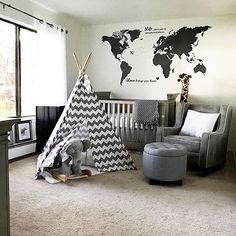 We created a calm and peaceful gray safari nursery using gray striped walls.