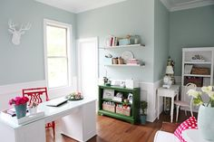 Palladian Blue, Benjamin Moore Colour Scheme: turquoise walls with bright red/coral and emerald green accents