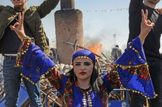 A young woman flashes the victory sign in front of a bonfire as Turkish Kurds gather during Newroz celebrations for the new year in Diyarbakir, southeastern Turkey, on 21st March 2018. Newroz (also known as Nawroz or Nowruz) is an ancient Persian festival, which is also celebrated by Kurdish people, marking the first day of spring.