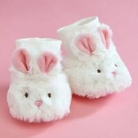 Keep tiny tootsies warm. Fluffy polyester slippers fit ages 0-12 months; 4-1/2