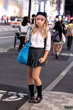 Japanese gyaru schoolgirls with tan skin and makeup showing