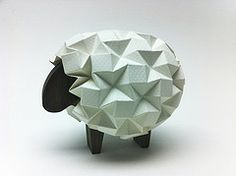 Sheep with Wooden Body Sheep with Wooden Body<br> Just a little experiment with my sheep design. I made a wooden body for the sheep. Love the contrast of wood with paper! I used a CNC router (ShopBot) to cut the sheep body out of walnut. Geometric Origami, Origami And Kirigami, Origami Box, Paper Crafts Origami, Oragami, Origami Stars, Cardboard Paper, 3d Paper, Polygon Art