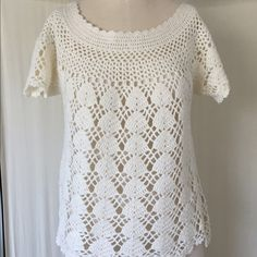 Crochet top Cream crochet top with short sleeves. Something must be worn underneath since the crochet design makes it see-through. Hardly ever worn and in perfect condition. Nurture Tops