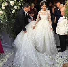 Giambattista Valli gown: http://www.stylemepretty.com/europe-weddings/france/normandy/2015/06/17/inside-the-magic-of-noor-fares-over-the-top-french-wedding-to-alexandre-al-khawam/