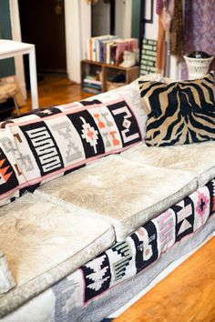 great way to spruce-up an old couch.  I love this idea.  And its a great way to change up your living room without buying new furniture