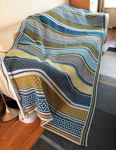 Nya Mosaic Blanket is made in a special crochet technique with only basic stitches involved. It can be crocheted either by following chart or written instructions.
