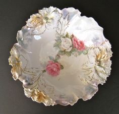 This large RS Prussia carnation mold bowl has so many beautiful features! The sculptural carnations around the edge are enhanced with peach lustre
