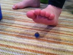 This sensory activity from Starfish Therapies will keep you on your toes! Work on body awareness by picking up marbles -- with your toes! Pinned by SPD Blogger Network. For more sensory-related pins, see pinterest.com/spdbn