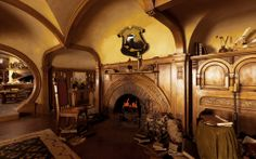This looks like someone took a scene from inside Bilbo's hobbit hole and put the Hufflepuff crest on the wall...