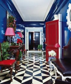 Cobalt blue pops with black and white decor and a touch of vivid red! Cobalt Blue Foyer | Cobalt Blue | Color Trend | Home Decor | Interior Design