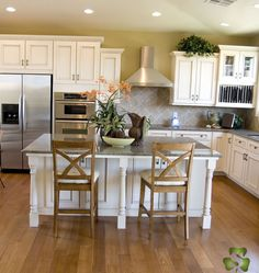 Kitchen Design Ideas Of The Week: Traditional Design With Antique White  Cabinets, Wood Floors, And A Kitchen Island With Chairs