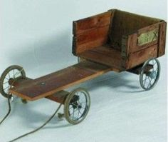 A homemade Go Cart made from wood and the wheels of a pram. We used to call them Bogeys.