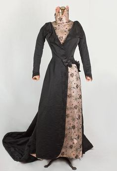 French beaded silk taffeta reception gown, c.1890. Made from black silk taffeta that opens over beaded net inserts. The wide lapels, cuffs, and front skirt opening are trimmed with scrolling black passementerie.