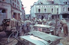 View of American troops and several Jeeps (including a press vehicle) in the town square in the wake of the D-Day invasion by Allied forces during World War II, Marigny (Manche), Normandy, France, Pin by Paolo Marzioli Jeep Willys, D Day Invasion, D Day Landings, Life Pictures, Ww2 Pictures, Ww2 Photos, Color Pictures, Life Magazine, Us Army