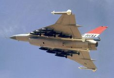 F-16XL - 3 - An air to air left underside view of an F-16XL aircraft. The aircraft is armed with two wing tip mounted AIM-9 Sidewinder and four fuselage mounted AIM-7 Sparrow missiles along with 12 500-pound bombs.