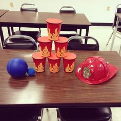 Fire Safety Activity! Fire Knock Down Game:) Get the children to knock down the fire cups using a blue ball (representing water) or take it outside for some fun and use a water gun to squirt them down! So much fun:)