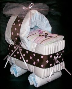 Baby Shower - nappies/diapers elegantly yet easy to put together with ribbon and bows.
