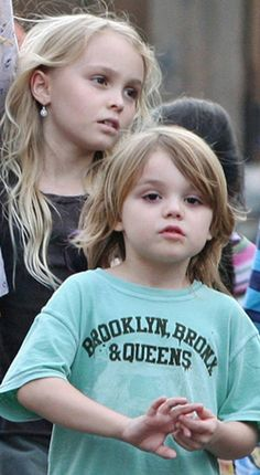 Johnny Depp's children. The girl in the back has his cheekbones. So.Awesome....tHEIR NAMES ARE LILLY ROSE AND JACK....