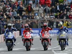 Norick Abe (L), Marco Melandri (2d L), Carles Checa (2d R) and Valentino Rossi ride during the Gauloises Fortuna Yamaha Team presentation 25 March 2004 in Barcelona. Yamaha will compete in the World Championship in the coming season.