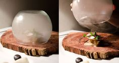 The Table - mushrooms and scallops are served on a raw wood plate and covered in a glass bowl filled with apple wood smoke