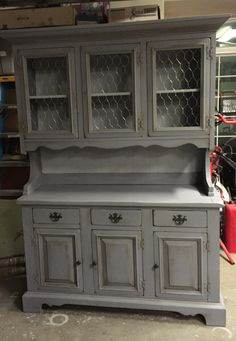 A custom order chalkpainted in a gray, dark waxed and added chicken wire.