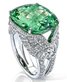 I don't normally pin jewelry but this stone is especially spectacular.  Green Sapphire Wing Ring by Garrard
