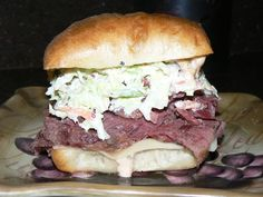 Hot Corned Beef, Creamy Cole Slaw, Swiss Cheese, and House Russian Dressing on a Toasted Ciabatta Roll | Yelp