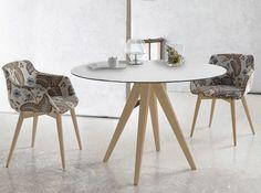 Mesa de comedor redonda con tapa de cristal y cerámica de 118 cm. Elige el color de patas que más te guste.  Podrás cambiar de mesa en cualquier momento ya que la tapa es reversible, cristal negro por un lado y cerámica por el otro.