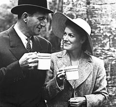 John Wayne and Maureen O'Hara have a cup of tea on the set of John Ford's 1952 film THE QUIET MAN.