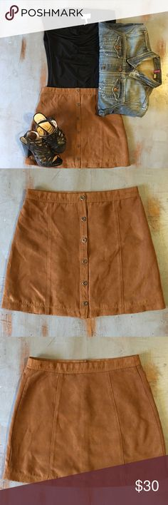 "Hollister faux suede skirt Beautiful deep dark tan colored faux suede Hollister skirt. Perfect for the fall and back to school. Buttons down the front. Very versatile. It measures 16"" long. Hollister Skirts Mini"