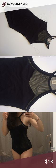 Brand New Never Worn Black Bodysuit This actually no longer has the tags on it because I was going to wear it for an event and changed my mind last minute. However, it's never been worn (only tried on) and is brand new. Made of cotton size small with a solid body and mesh top. Fits in the back the at a normal bathing suit would, not too cheeky. Bundle for discounts! Tops Crop Tops