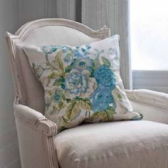 Blithfield -  Collection V Fabric Collection - A vintage style blue and green floral scatter cushion, on a painted wooden armchair with a padded white seat and back