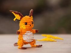 DeviantArt user Agent Doppelnuller creates impressive little sculptures of Pokémon characters out of wire and small colorful beads.