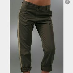 """Current Elliott """"Tux Captain Trouser"""" Pants These cropped, slouchy twill pants feature a metallic ribbon stripe at the sides. Slant front pockets and welt back pockets. Worn edges. Single-button closure. 14"""" leg opening.  Color: Army Green  * 10.5"""" rise. 27"""" inseam (uncuffed). * 21.5"""" inseam (cuffed). * Fabrication: Twill. * 100% cotton. * Wash cold. * Imported. Current/Elliott Pants"""