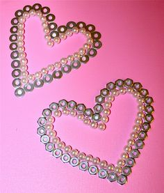 DIY heart decor with shiny washers and pearly beads.