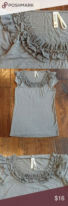 """EUC Kische ruffle top Super soft, comfy and flattering! Quality made. Looks great dressed up or down 26""""L. 16"""" at narrowest part of waist 17"""" by the bottom. This fabric is funny in that the wrinkles disappear when you put it on. Kische Tops Tees - Short Sleeve"""
