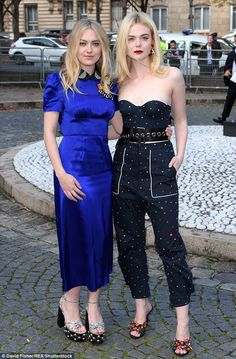 Family affair: Elle Fanning, 19, was sure to support her favourite fashion brand as she stepped out in Paris on Tuesday for the fashion house's SS18 runway show during Fashion Week alongside her older sister Dakota, 23