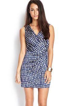 Love 21 - A sleeveless woven dress featuring a dotted print and surplice front with a gathered si...