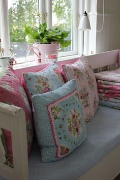 These are so pretty.  Lovely cushions in our bench