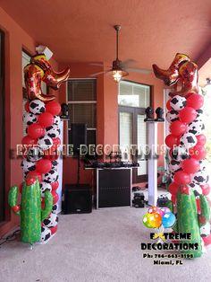 Western theme, Cowboy Boots Balloon columns - Cactus, cow print balloons. Extreme Decorations Miami, FL 786-663-8198