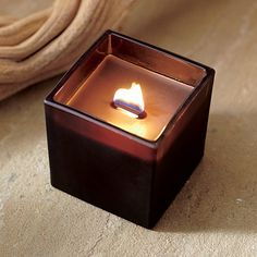 "Ebony Oud Square Wooden Wick Candle Fills a room with crackling warmth and the mystical notes of a rare and ancient Asian wood used to scent Eastern temples. A genuine wooden wick adds to the masculine appeal. Sprayed-color glass. 3 1/4""h, 3"" square. Burn time: 20-35 hours. www.candleswithkathryn.partylite.com.au"