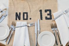 table numbers printed directly onto burlap runner // photo by HelloStudioBlog.com