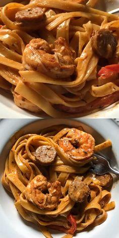Creamy Cajun Shrimp Pasta with Sausage, spicy and creamy Creole pasta with blackened shrimp and andouille sausage. A spicy and creamy cajun shrimp pasta dish with blackened shrimp and andouille sausage. Shrimp And Sausage Pasta, Shrimp Pasta Dishes, Creamy Cajun Pasta, Cajun Sausage, Sausage Pasta Recipes, Cajun Shrimp Pasta, Easy Chicken Dinner Recipes, Jerk Chicken Pasta, Cajun Shrimp Recipes