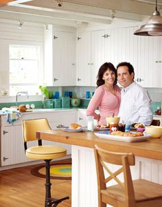 tony shalhoub brooke adams kitchen home.  i like the basic galvanized hinges with the simple cupboard doors