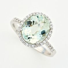 green amethyst & diamond ring