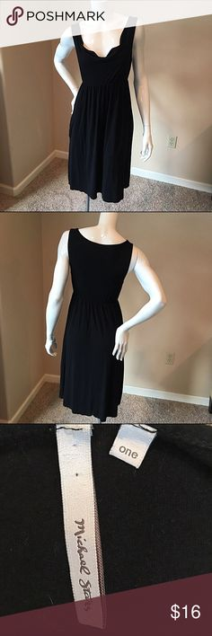 Michael Stars size one black jersey basic dress Michael stars size one or size small black jersey drape neck basic dress. Fabric tag is taken out however I believe it's 100% rayon. Bust 14 inches, waist 12 inches, length 35 inches. Michael Stars Dresses Midi