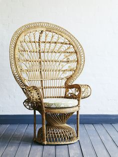My parents used to have a set of chairs just like these in our sunroom. They always reminded me of that one Al Green cover where he's dressed all in white. Peacock Chair in Natural by The Family Love Tree.