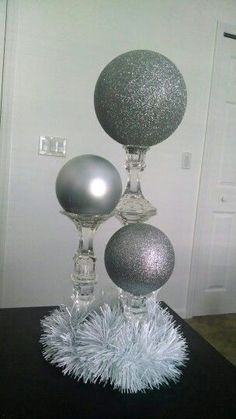 DIY Dollar Tree candlesticks. 2 glued together for medium height, and 3 for the tallest. Place large ornaments on top, or paint Styrofoam spheres. Voila! Inexpensive Winter Wonderland wedding decor! Short centerpieces #WhiteGlitter