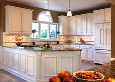 By refacing their cabinets and adding a new countertop, transforming their time-worn tired kitchen to an elegant showplace was easy.